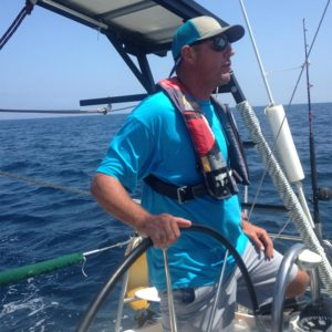 Captain Clint Sutter at the helm